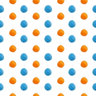 Watercolor polka dots painting in gradient orange and blue spotted in seamless pattern on white.