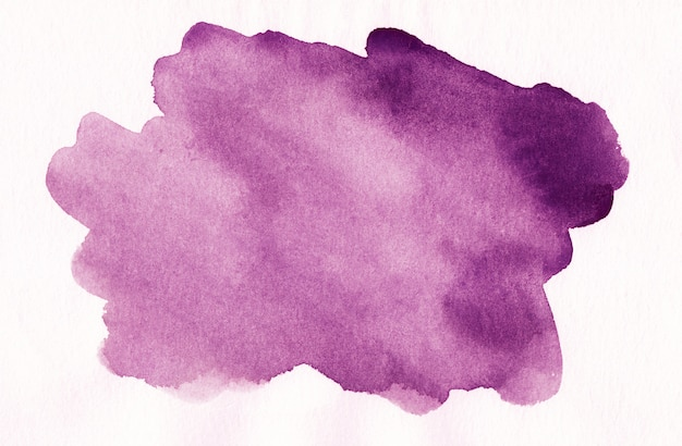 Watercolor purple spot on white textured paper