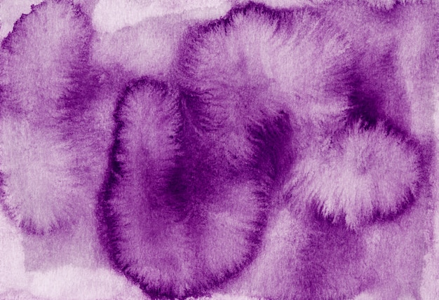 Watercolor purple stains on white paper background. hand painted