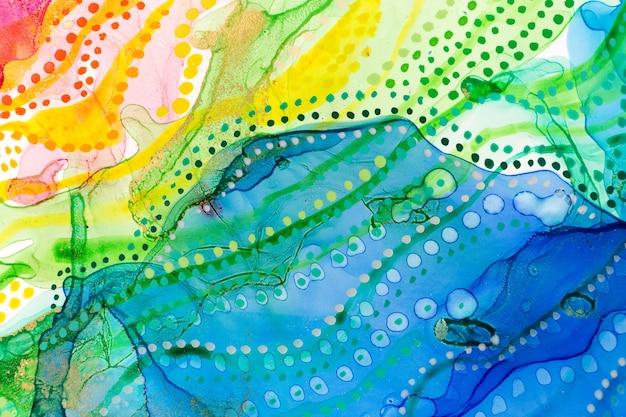 水彩虹の抽象的な汚れとドットの背景インクグラデーションテクスチャ