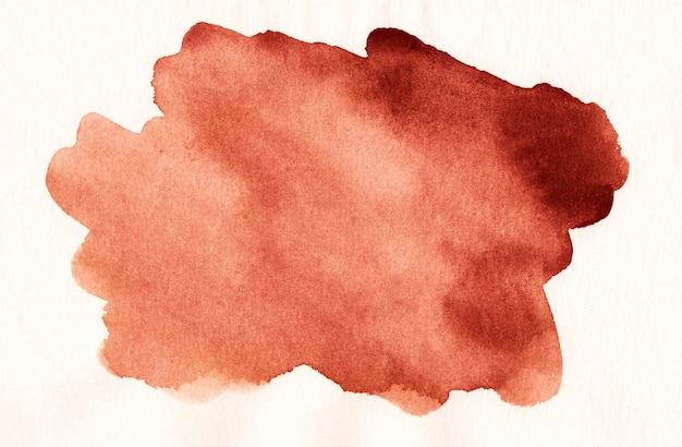 Пятно акварели красное на белой текстуре предпосылки. ржавые цветные пятна на бумаге.