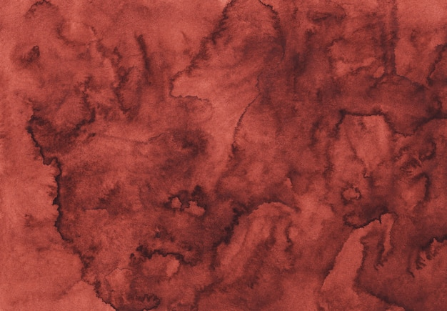 Watercolor red texture background hand painted. liquid maroon color backdrop. stans on paper.