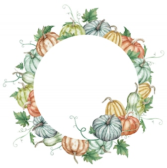 Watercolor round frame with colorful pumpkins and green leaves. botanical autumn illustration.