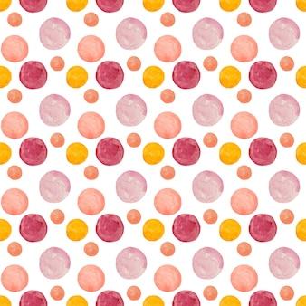水彩の丸い汚れドットパターン。白い背景の上のオレンジ、ピンク、黄色のドットとのシームレスなパターン。手描きの抽象的な壁紙