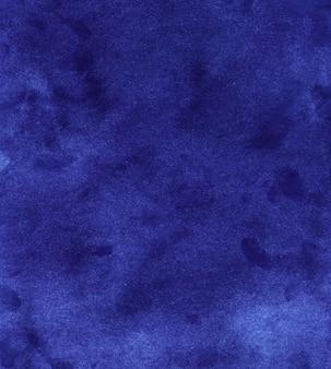 水彩のロイヤルブルーの背景のテクスチャです。ダークブルーの背景、手描き
