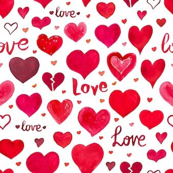 心と水彩のシームレスな背景。バレンタインデーのパターン。