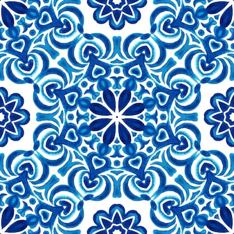 Watercolor seamless pattern hand drawn art. round mandala with hearts blue and white tile azulejo