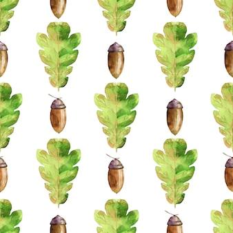 緑のカシの葉とどんぐりと水彩のシームレスなパターン。