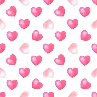 Watercolor seamless pattern with pink, red hearts on white background