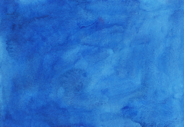 Watercolor sky blue background texture hand painted. cerulean stains on paper.