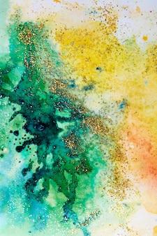 Акварельные пятна желто-зеленые с блестками. абстрактный фон