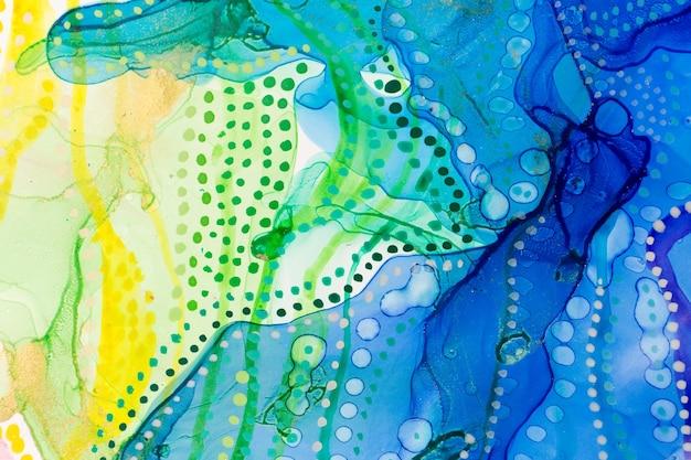 水彩の夏の抽象的な汚れとドットの背景インクグラデーションテクスチャ