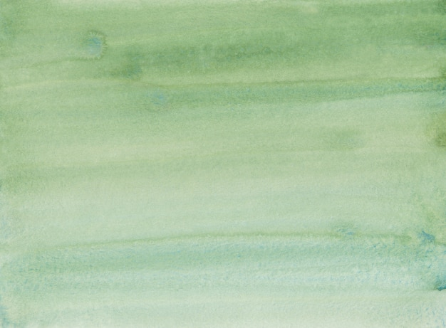 Watercolor turf green color gradient background. water color green ombre painting. brush strokes on paper.