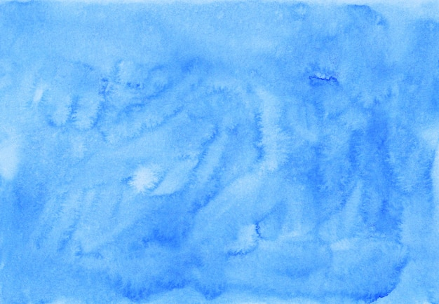 Watercolor watery light blue background painting. hand painted watercolour background texture. sky blue stains on paper.
