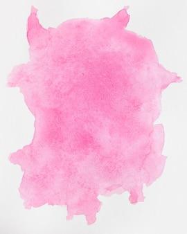 白い背景の水彩画の液体ピンクはね