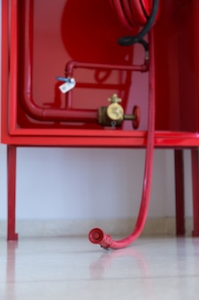 Watercourse fire extinguisher red.