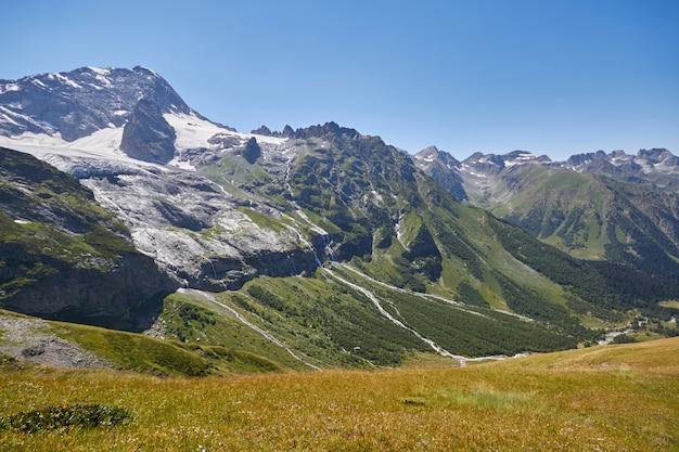 Waterfall in the caucasus mountains, melting glacier ridge arkhyz