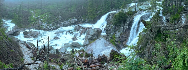 Waterfall in the great cold valley summer cloudy view