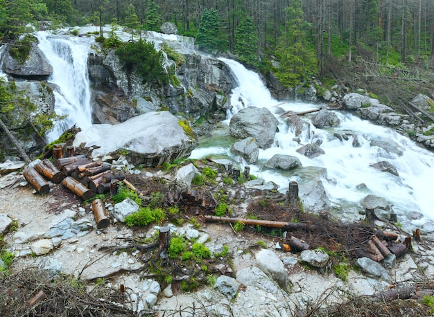 Waterfall in great cold valley summer view. high tatras, slovakia.