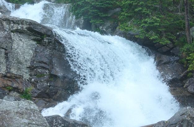 Waterfall in great cold valley (velka studena dolina) summer view. high tatras, slovakia.