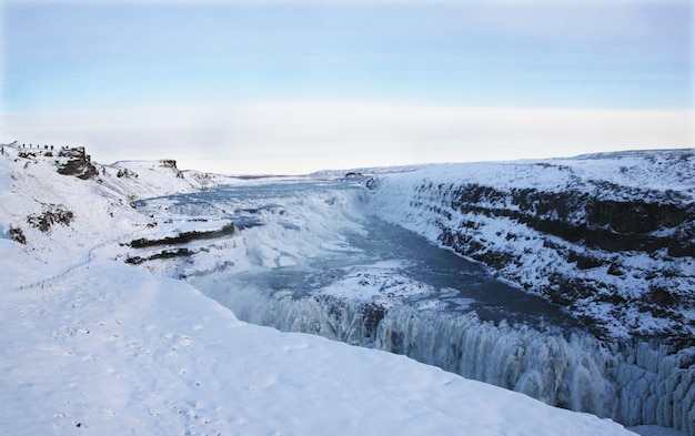 Waterfall of gullfoss in iceland, europe surrounded by ice and snow
