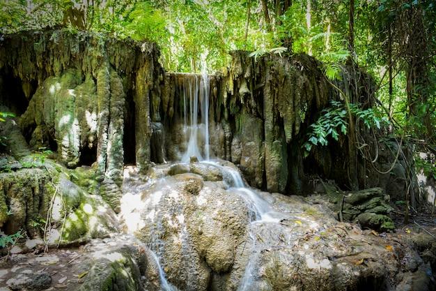 Waterfall hidden in the tropical jungle (erawan waterfall)
