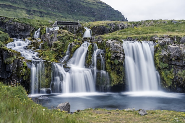Waterfall on the kirkjufell mountain at daytime in iceland