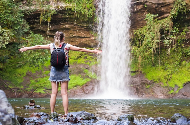 A waterfall to relax woman with open arms