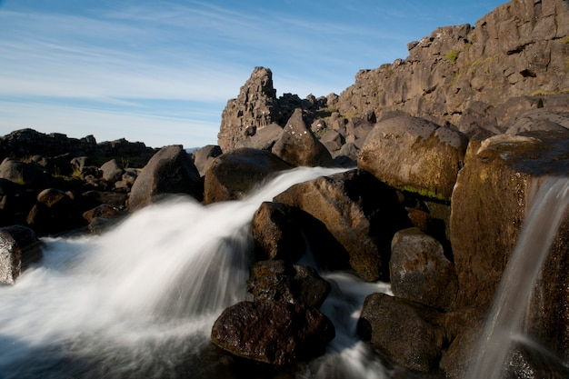 Waterfall through rugged terrain of rock and boulders