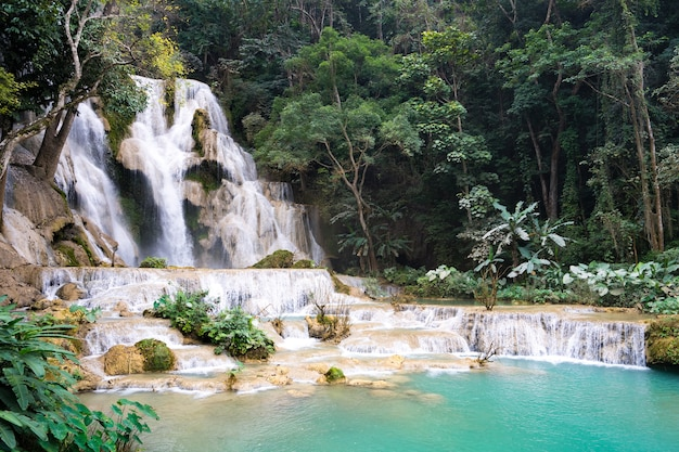 Waterfall in tropical forest at kuang si water fall in luang prabang, laos.