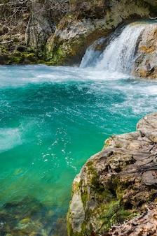 Waterfall in urederra natural park, navarre, spain.