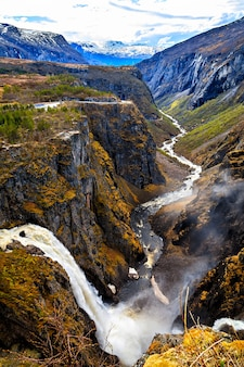 The waterfall voringfossen and the river flowing through the gorge