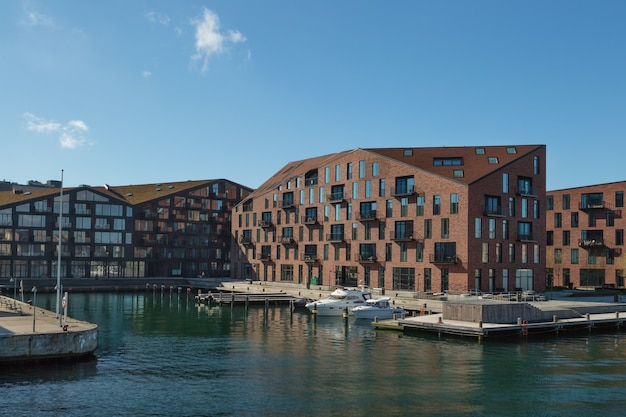 Waterfront of christianshavn district with boats and residential buildings.