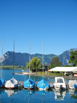 The waterfront of thun in switzerland with yachts on a sunny summer morning