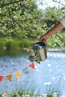 Watering can to cool down in summer in nature