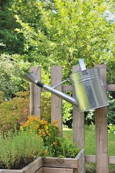 Watering can in rustic garden