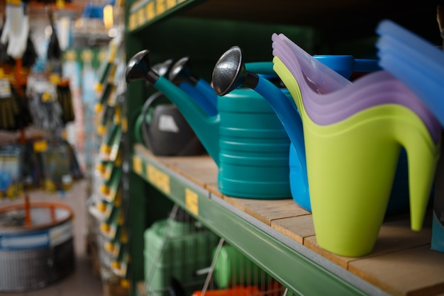 Watering cans assortment on the shelf