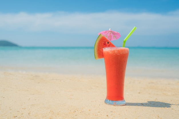Watermelon cocktail on blue tropical summer beach in phuket, thailand
