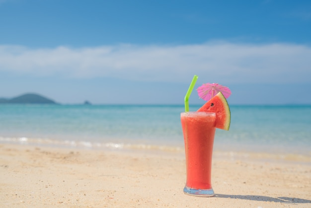 Watermelon cocktail on blue tropical summer beach in phuket, thailand.