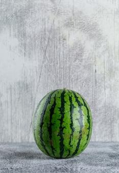 Watermelon on grey grunge table