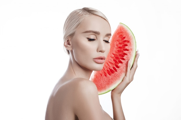 Watermelon in hands of women, clean smooth skin