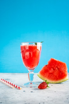 Watermelon juice in glass with strawberry on top