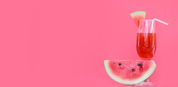 Watermelon juice summer with piece watermelon fruit glass on red background , copy space