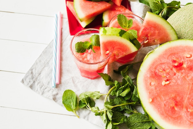 Watermelon mint drinks and straws on napkin