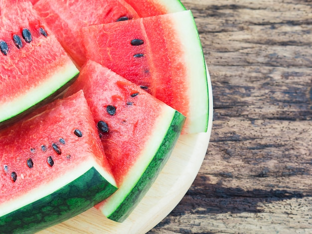 Watermelon on old wooden background