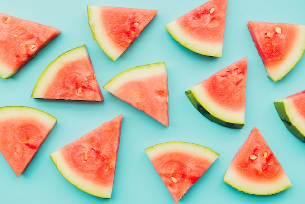 Watermelon pieces on azure background