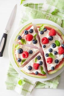 Watermelon pizza slices with yogurt and berries, summer dessert