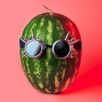 A watermelon punk in rocker glasses on pink