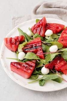 Watermelon salad on white plate
