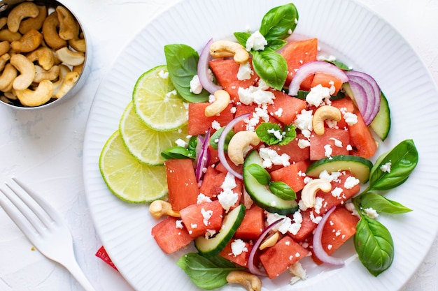 Watermelon salad with cashew nuts and feta